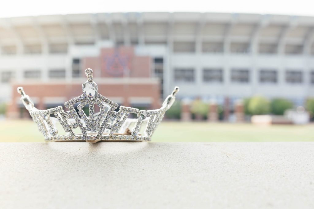 The Miss AU crown is in the foreground as the Jordan-Hare Stadium is out of focus in the background.