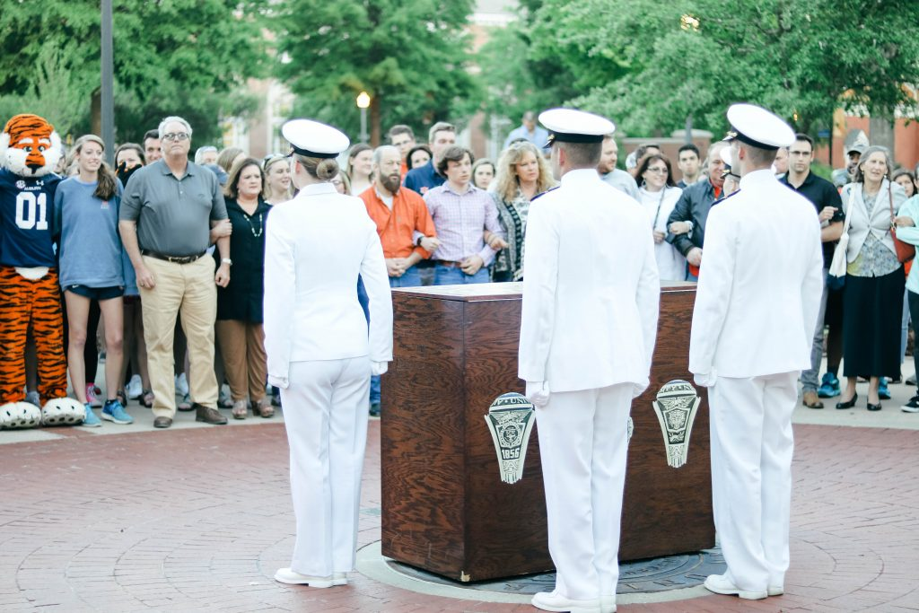 Members of ROTC place the ring box in position over the Auburn Seal at the Ring Night event.
