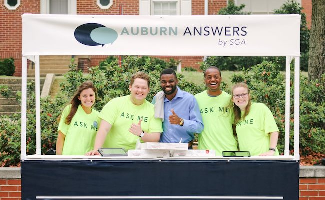 "Student Government Association members are in ""Ask Me"" t-shirts as they work at the Auburn Answers booth during the Auburn Answers event."