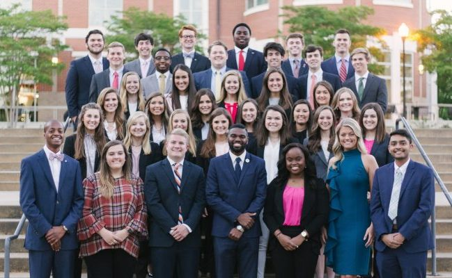 Past senators stand on the steps of the Student Center for a group photo.
