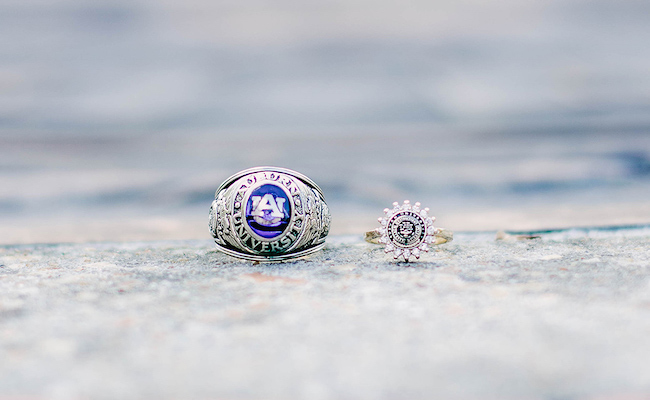 The traditional ring and women's dinner ring sit on top of the Auburn seal- that sits in front of Langdon Hall on campus.
